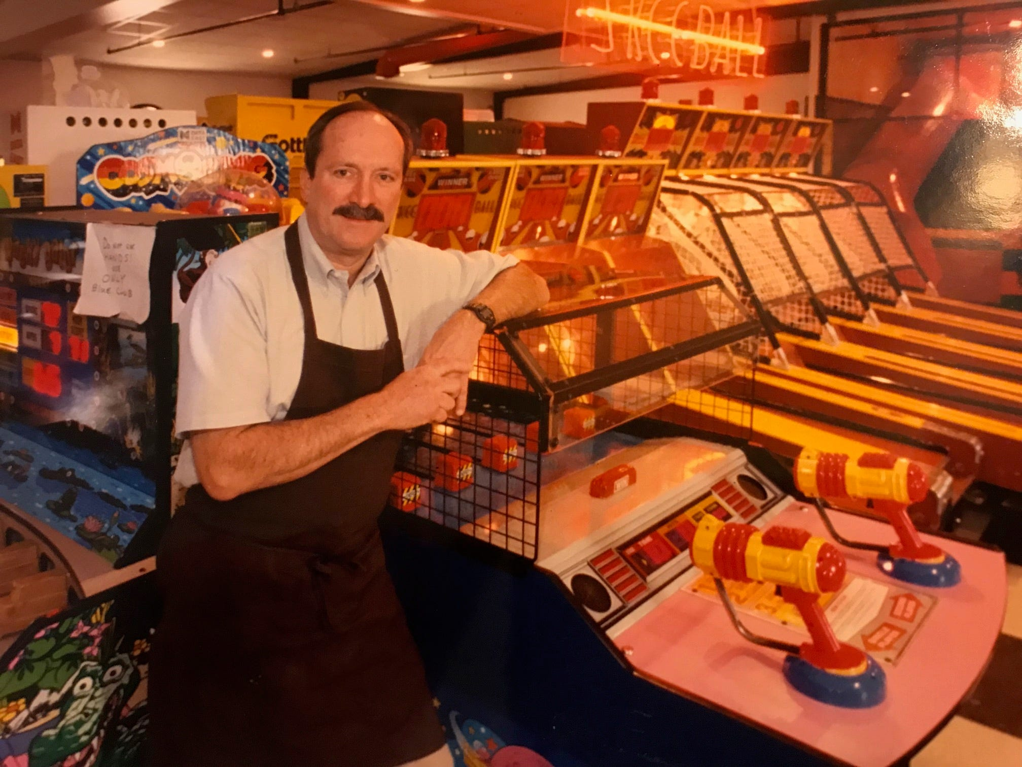 Owner John Dean stands in the game room of Shakey's Pizza in this 1992 file photo. Dean started work at the restaurant in 1968, and bought the franchise from Norman Hand.