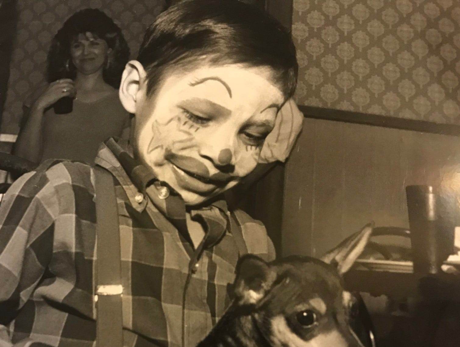 """Christopher Juarez, 6, pets his new Chihuahua puppy, which was presented during a birthday party at Shakey's Pizza in San Angelo in this April 1989 file photo. He named the puppy """"C.J."""""""