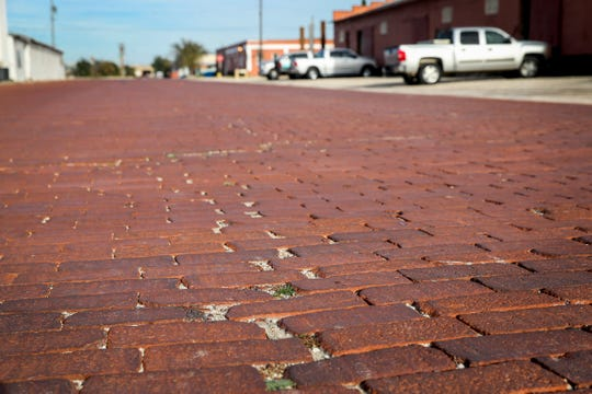 Bricks line 4th street between Chadbourne and Oakes streets in downtown San Angelo. While once a common sight in most Texas towns, brick streets have become scarce in West Texas.