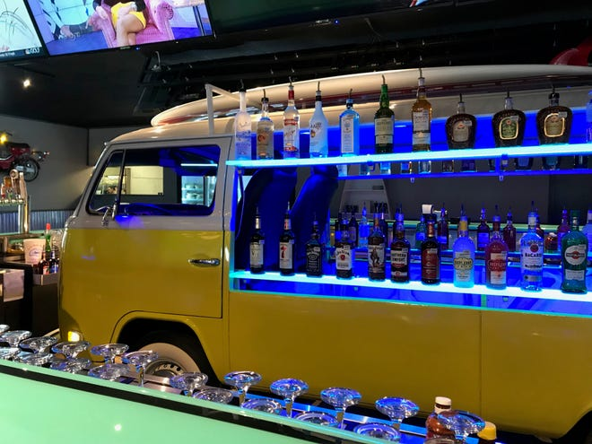 A Volkswagen van takes center stage at the beach themed The Boat Oyster Bar and Grill, 2715 Sherwood Way on Nov. 28, 2018.
