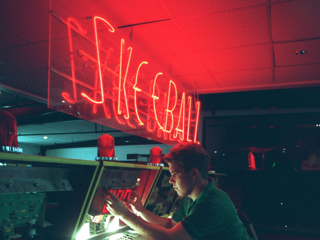 Shakey's Pizza employee Ben Thompson works on one of the skeeball games in this June 1995 file photo.