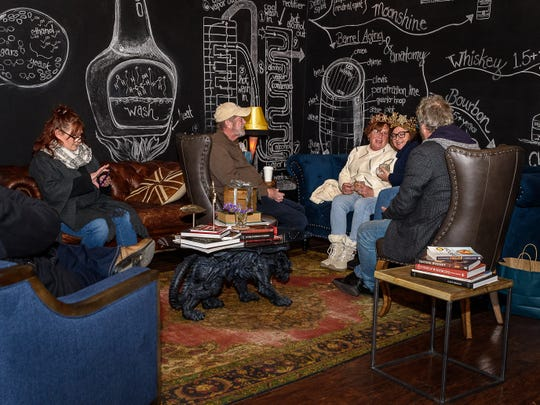Guests relax in the lounge at Cape Charles Distillery on Festive Friday.