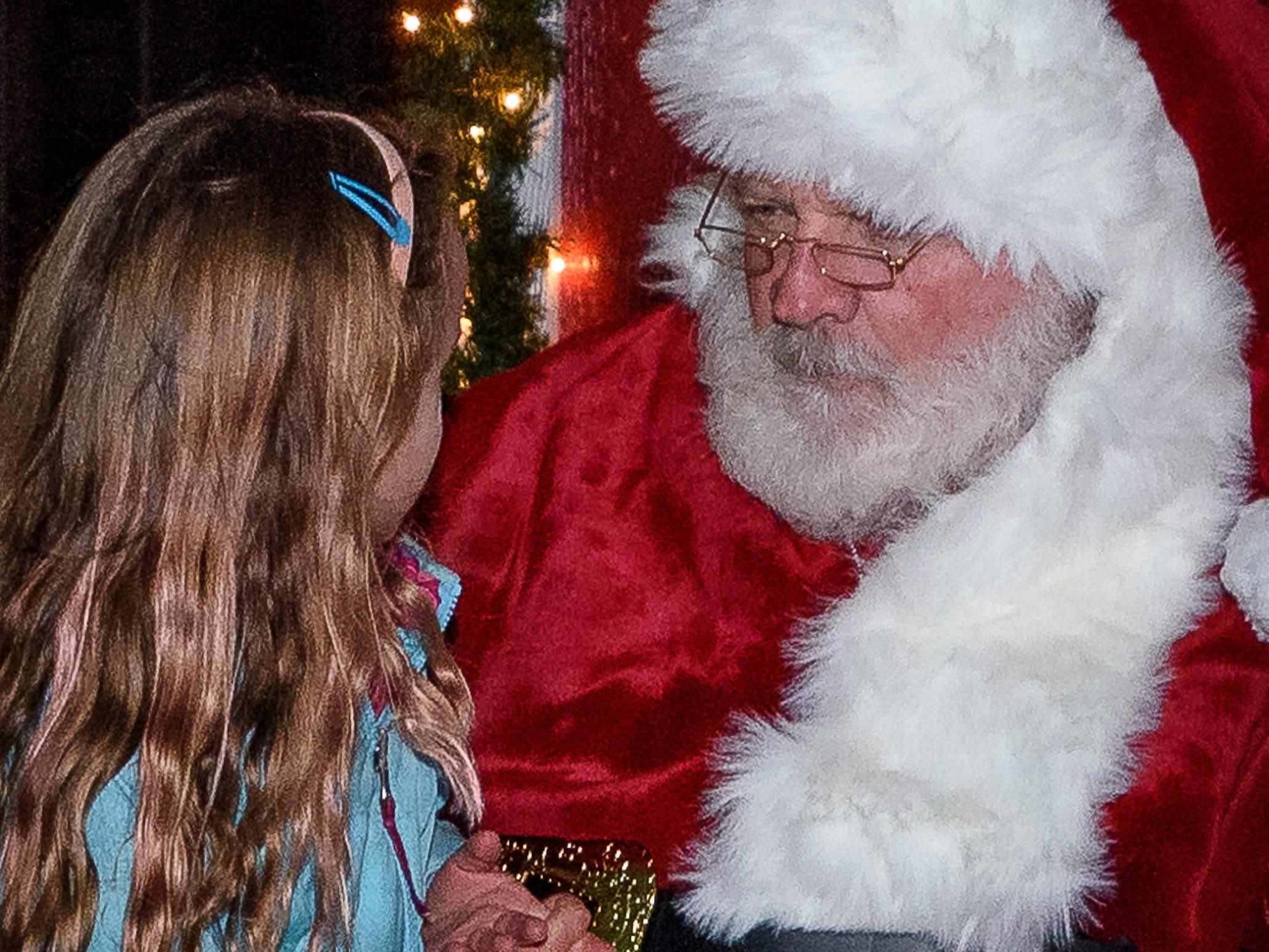 Santa hears the Christmas list from a young girl during Festive Friday on Nov. 23.