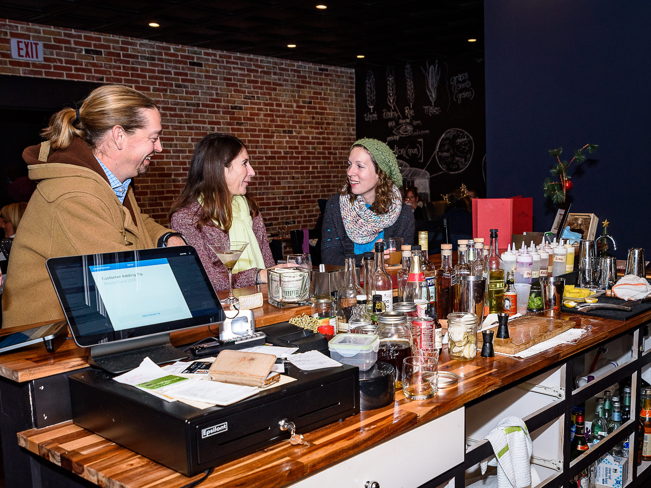 Patrons enjoy cocktails at Cape Charles Distillery during Festive Friday on Nov. 23.