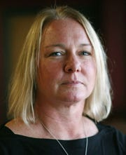 Kristi TeRonde-Heimerl in a portrait at Mead Library, Tuesday, November 27, 2018, in Sheboygan, Wis.  TeRonde-Heimerl said that it took her and her family years to process the suicide death of her brother.