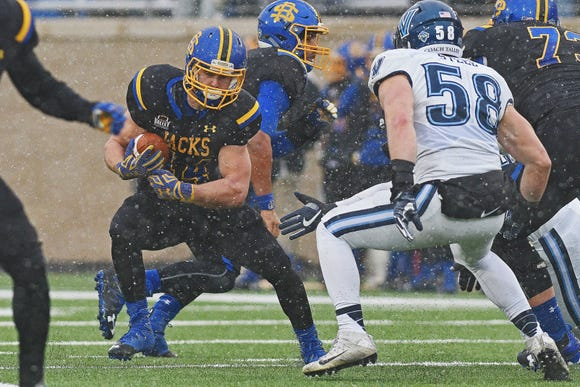 SDSU's Brady Mengarelli (44) carries the ball during playoff game against Villanova Saturday, Dec. 3, 2016, at Dana J. Dykhouse Stadium on the SDSU campus in Brookings, S.D.