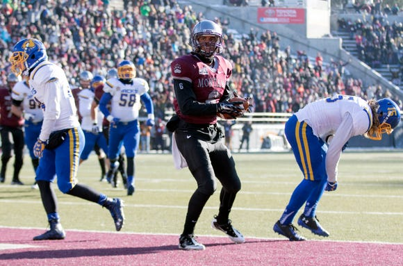 Montana wide receiver Jamaal Jones (6) scores a touchdown against South Dakota State during the first half of a first round game in the NCAA college Football Championship Subdivision playoff, Saturday, Nov. 28, 2015, in Missoula, Mont.