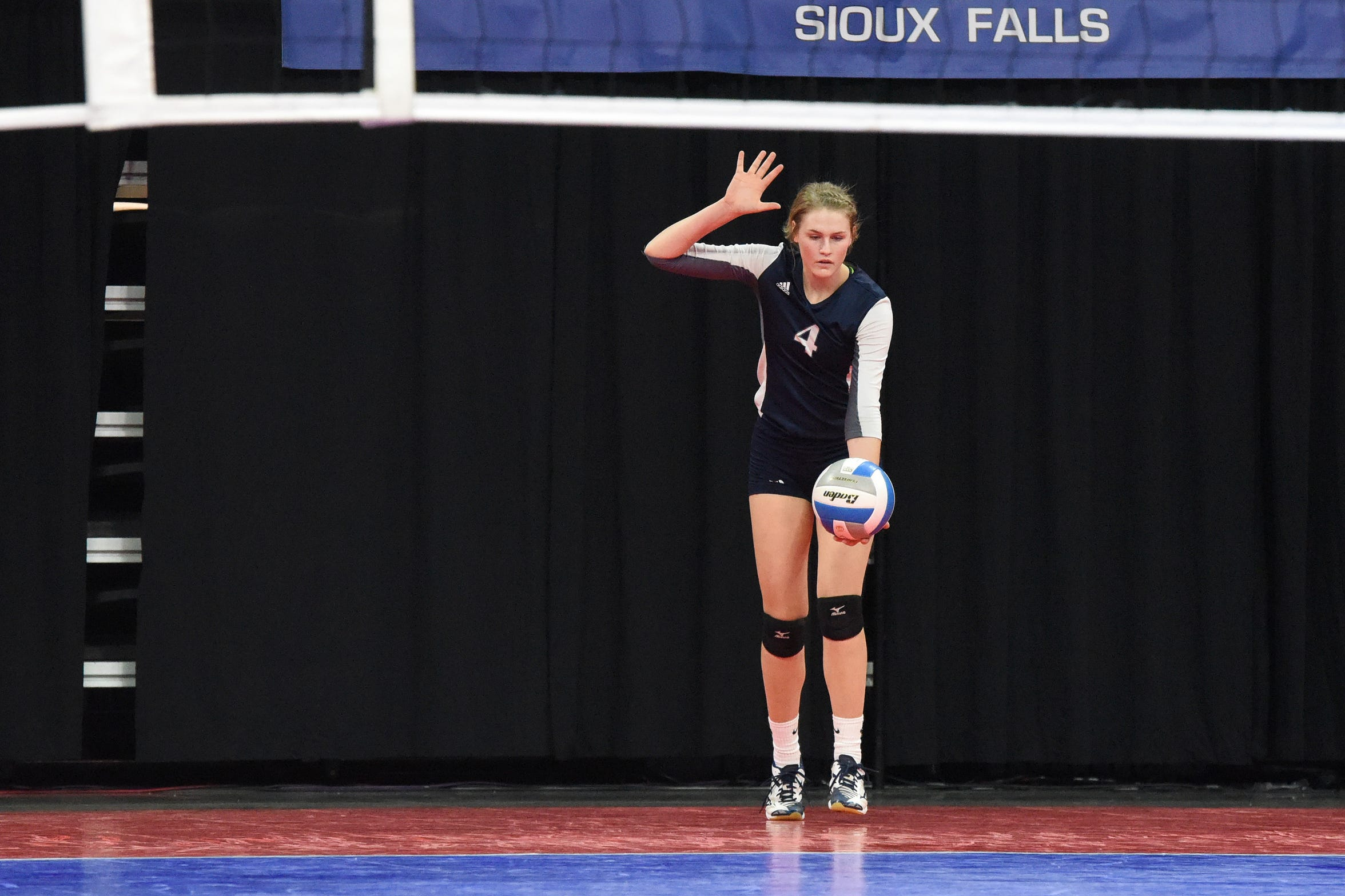 Burke's Taylee Indahl (4) prepares to serve the ball during a match against Ethan, Friday, Nov. 16, 2018, at the Denny Sanford Premier Center in Sioux Falls, S.D.