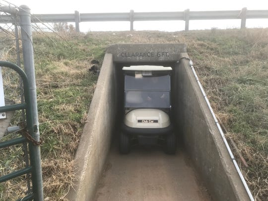 This narrow tunnel under Interstate 44 connects the rest of the 18-hole course to holes 12 through 16 at Deer Lake Golf Course.  A golf cart barely fits through the tunnel.