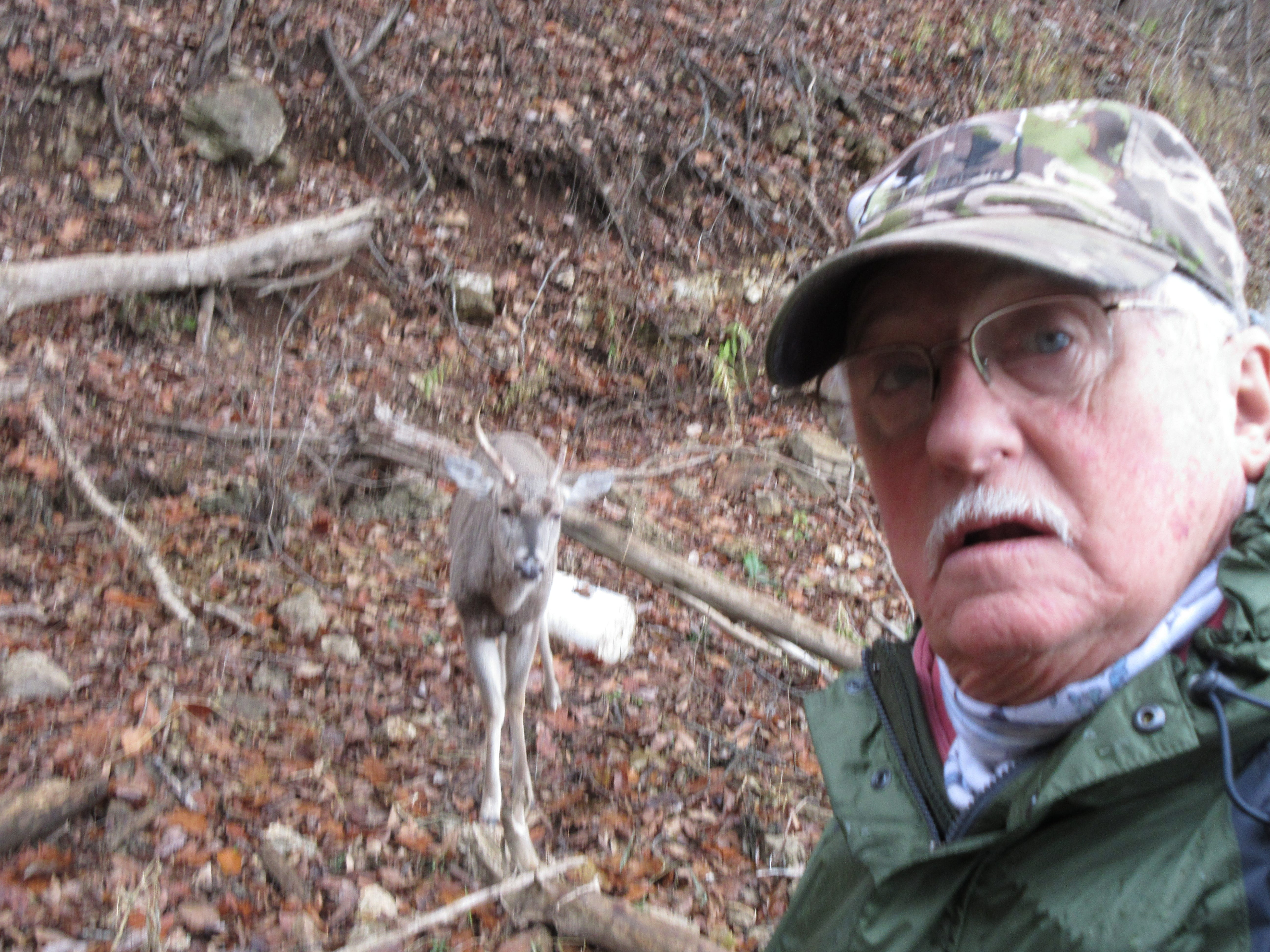 A small buck injured while scrambling down the hill allowed Larry Rottmann to approach.