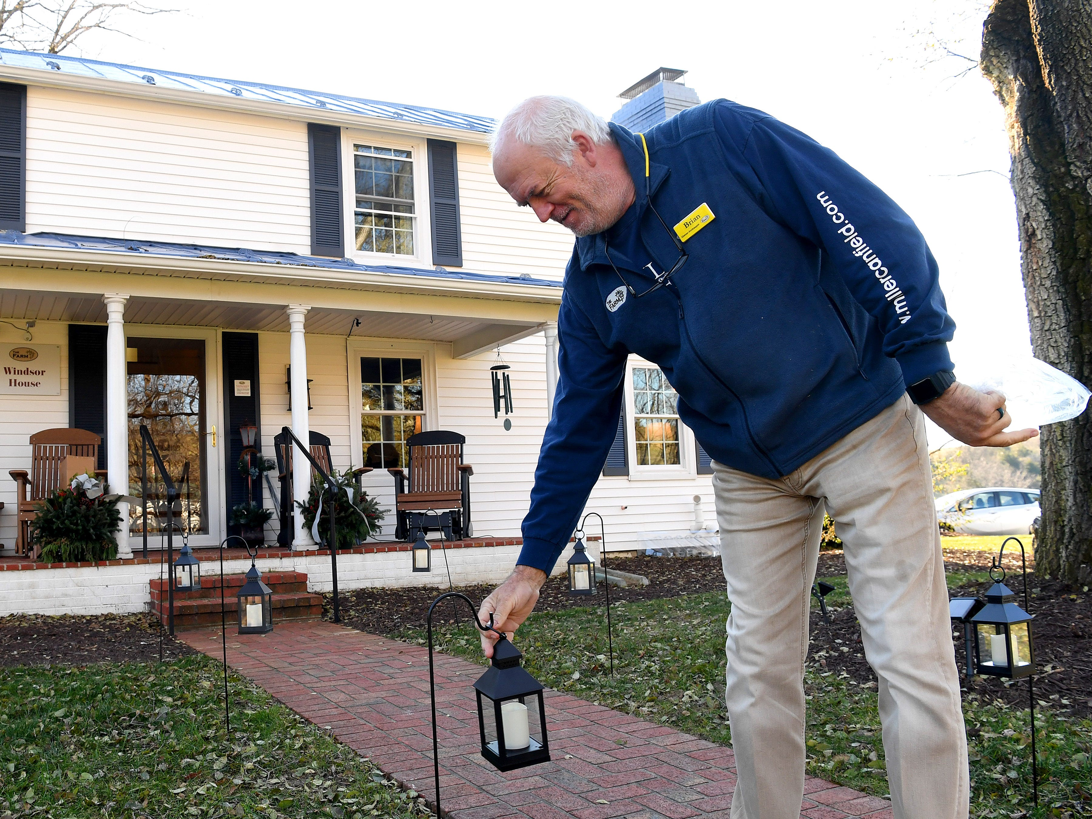 Co-owner and innkeeper Brian Westenberg hands lanterns along a walkway leading up to the front of the Inn at WestShire Farms in Staunton on Wednesday, Nov. 28, 2018.