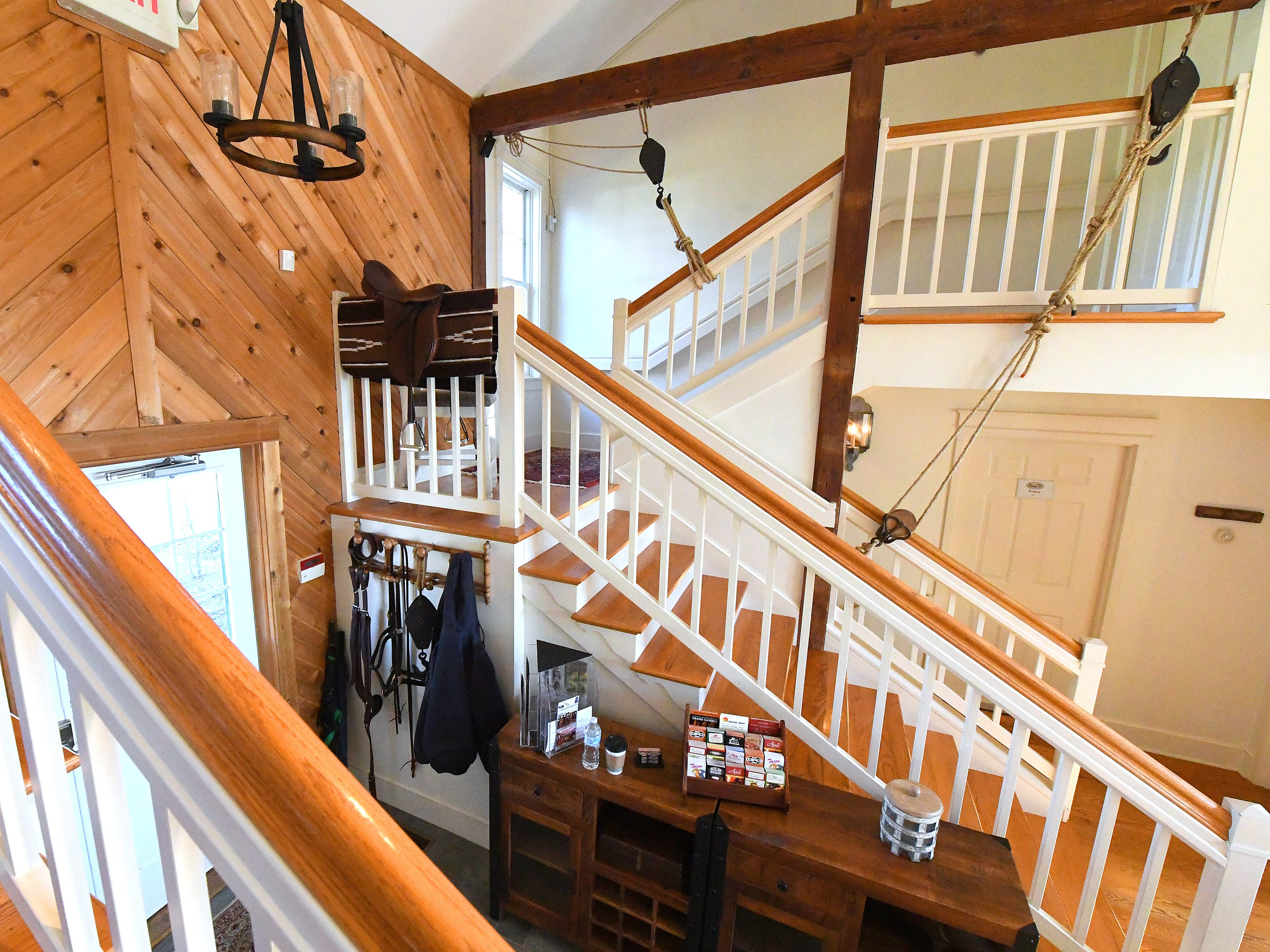 Stairs lead up to the some of the various rooms inside the Millstone Barn at the Inn at WestShire Farms in Staunton.