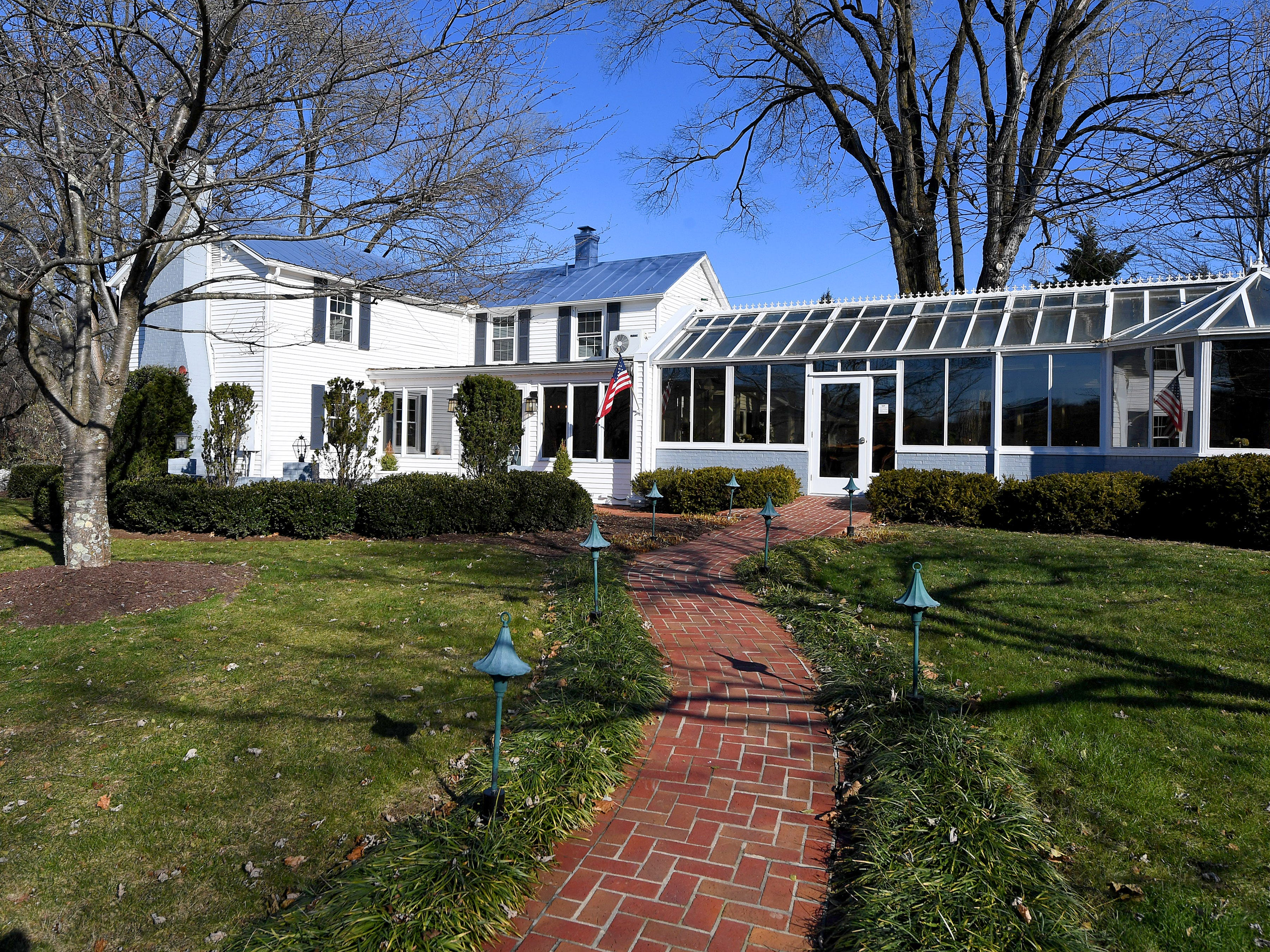 A walkway leads to the Inn at WestShire Farms in Staunton.