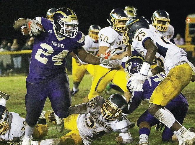 Senior running back K.J. Dameron, left, who has rushed for almost 1,300 yards this season, is a big reason the Trojans are riding a seven-game win streak coming into Saturday's VHSL Class 1 semifinal against Riverheads.
