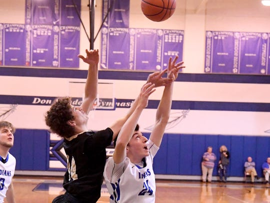 Buffalo Gap's Cameron Lyle battles Fort Defiance's Ryan Cook for the rebound during a basketball game played in Fort Defiance on Tuesday, Nov. 27, 2018.