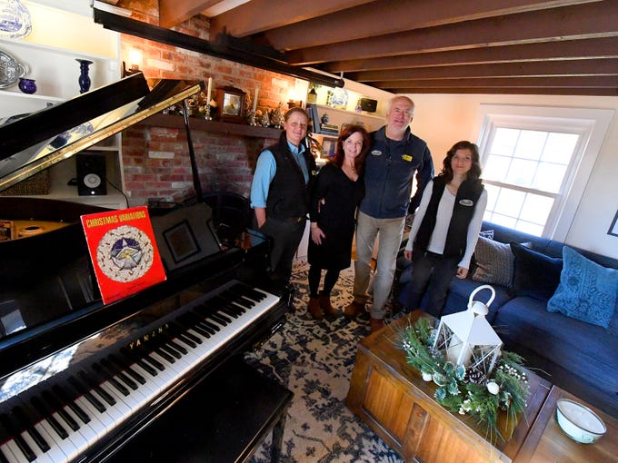 Owners and innkeepers Brian Westenberg and Katherine Rook stand with assistant innkeeper Gretchen Daub (left) and marketing specialist Amber Hancock (right) in the living room at the Inn at WestShire Farms in Staunton on Wednesday, Nov. 28, 2018.
