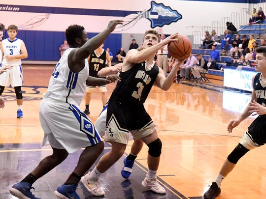 Buffalo Gap's Weston Smith looks to the basket to shoot as he is guarded by Fort Defiance's Treavon Winston during a basketball game played in Fort Defiance on Tuesday, Nov. 27, 2018.
