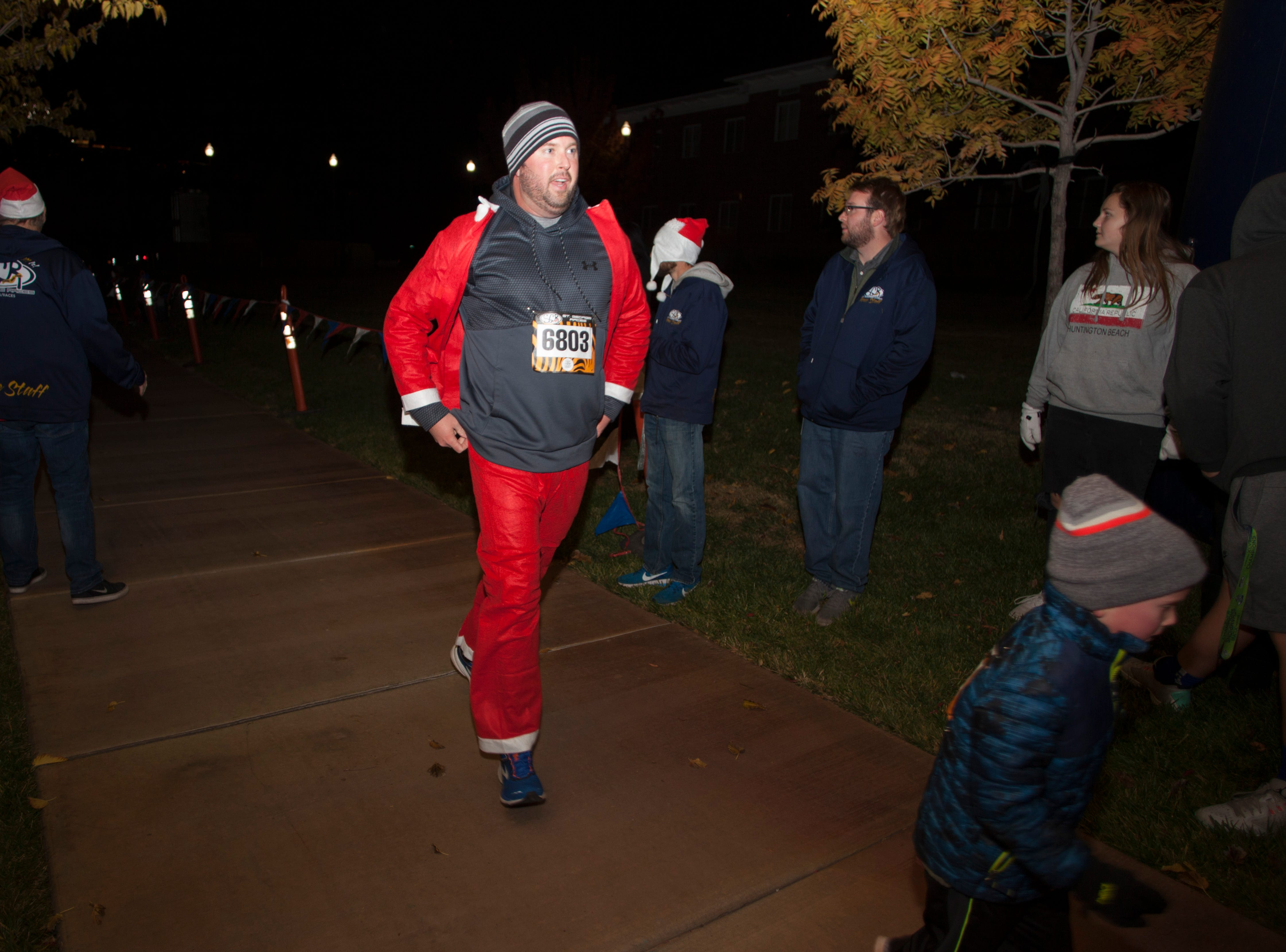 Community members gather at the town square to run the Santa Dash and commemorate the lighting of the Christmas lights Monday, Nov. 26, 2018.