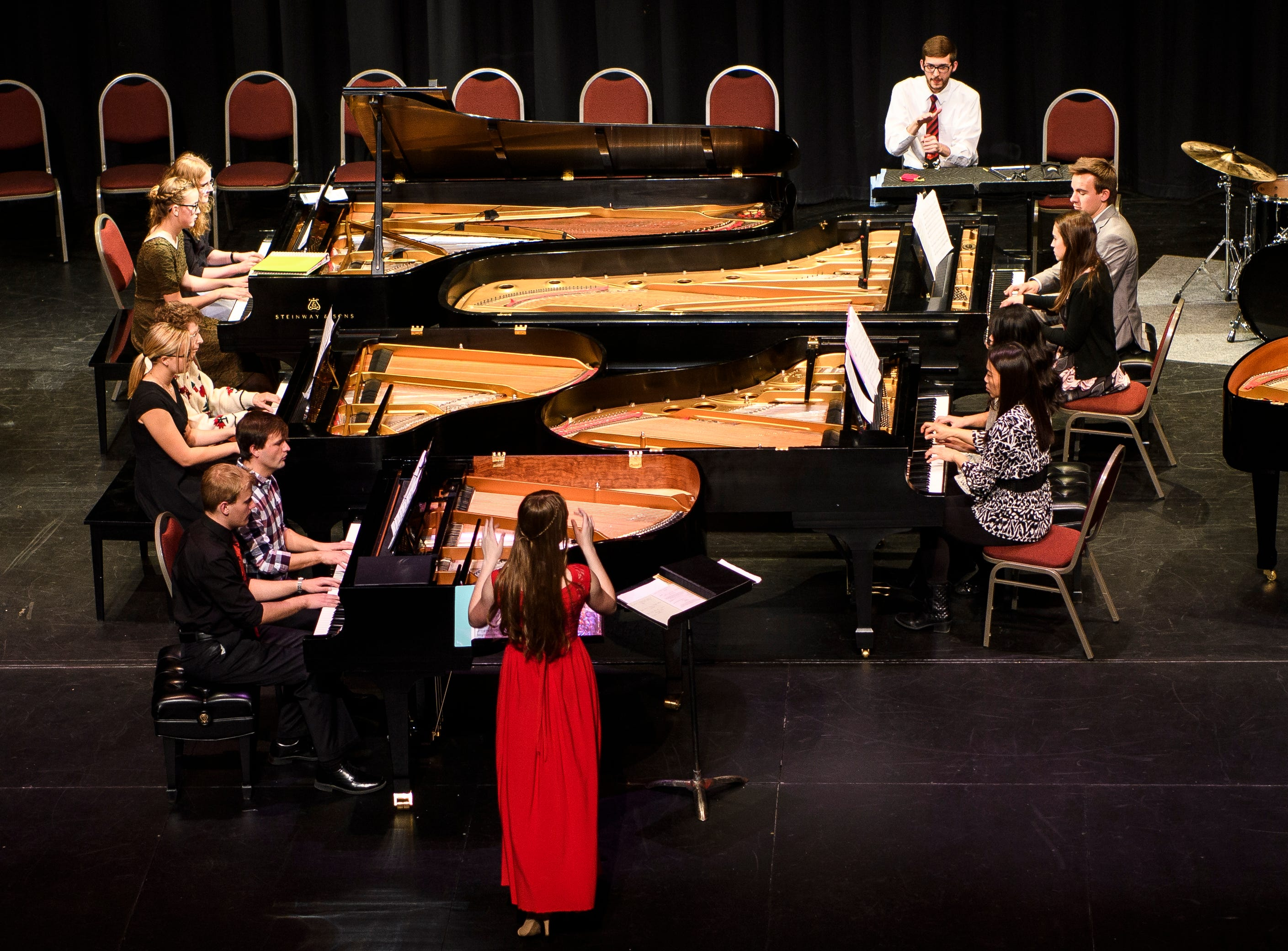 Musicians of all ages play nine grand pianos at once in the Piano Monster Concert in the Heritage Center Theater Tuesday, November 27, 2018. The concert was hosted by the Southern Utah University music department, and featured numerous Christmas songs.