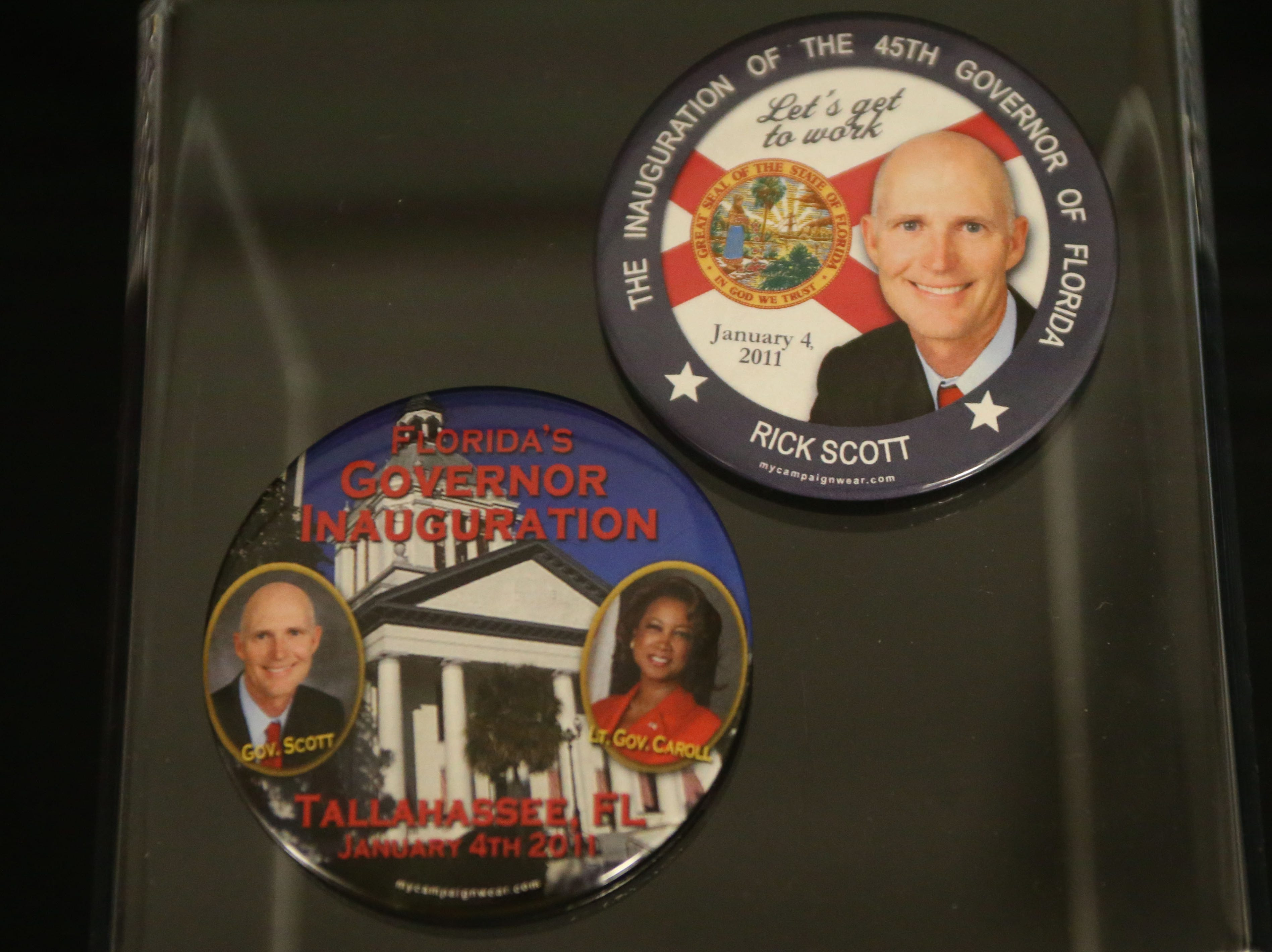 The Tallahassee historic Capitol hosts an exhibit on inaugurations of years past, Wednesday, Nov. 28, 2018. Displayed are buttons that Rick Scott gave out at his inauguration.