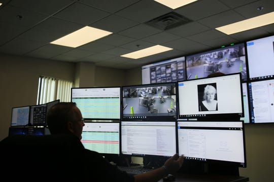 Leon County Sheriff's Office Capt. and intelligence analyst Jimmy Goodman monitors screens inside the agency's newly opened Real Time Crime Center.