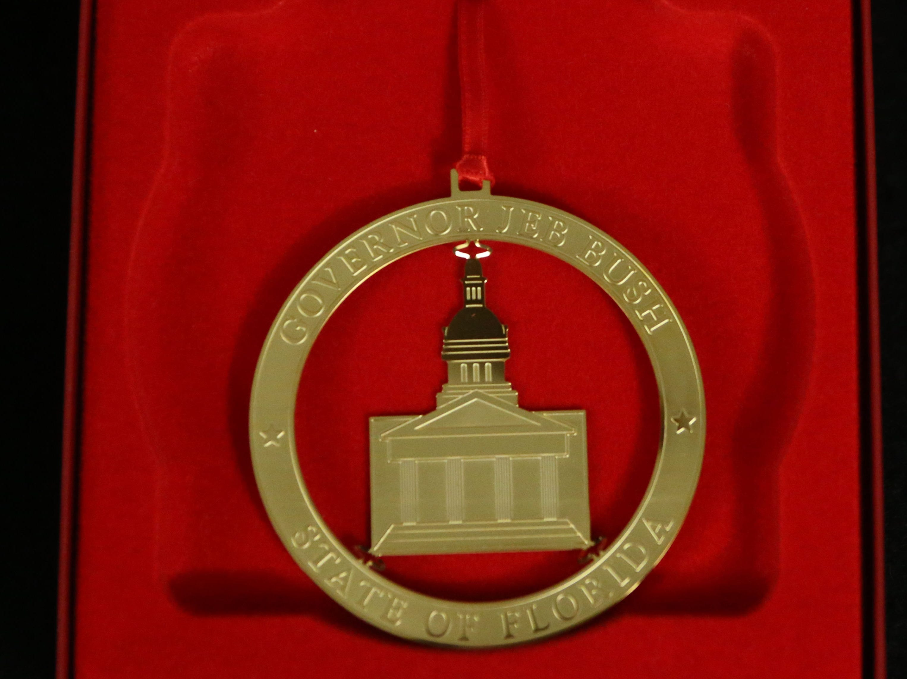 The Tallahassee historic Capitol hosts an exhibit on inaugurations of years past, Wednesday, Nov. 28, 2018. Displayed is an ornament which was given out by governors at the inaugural ball.