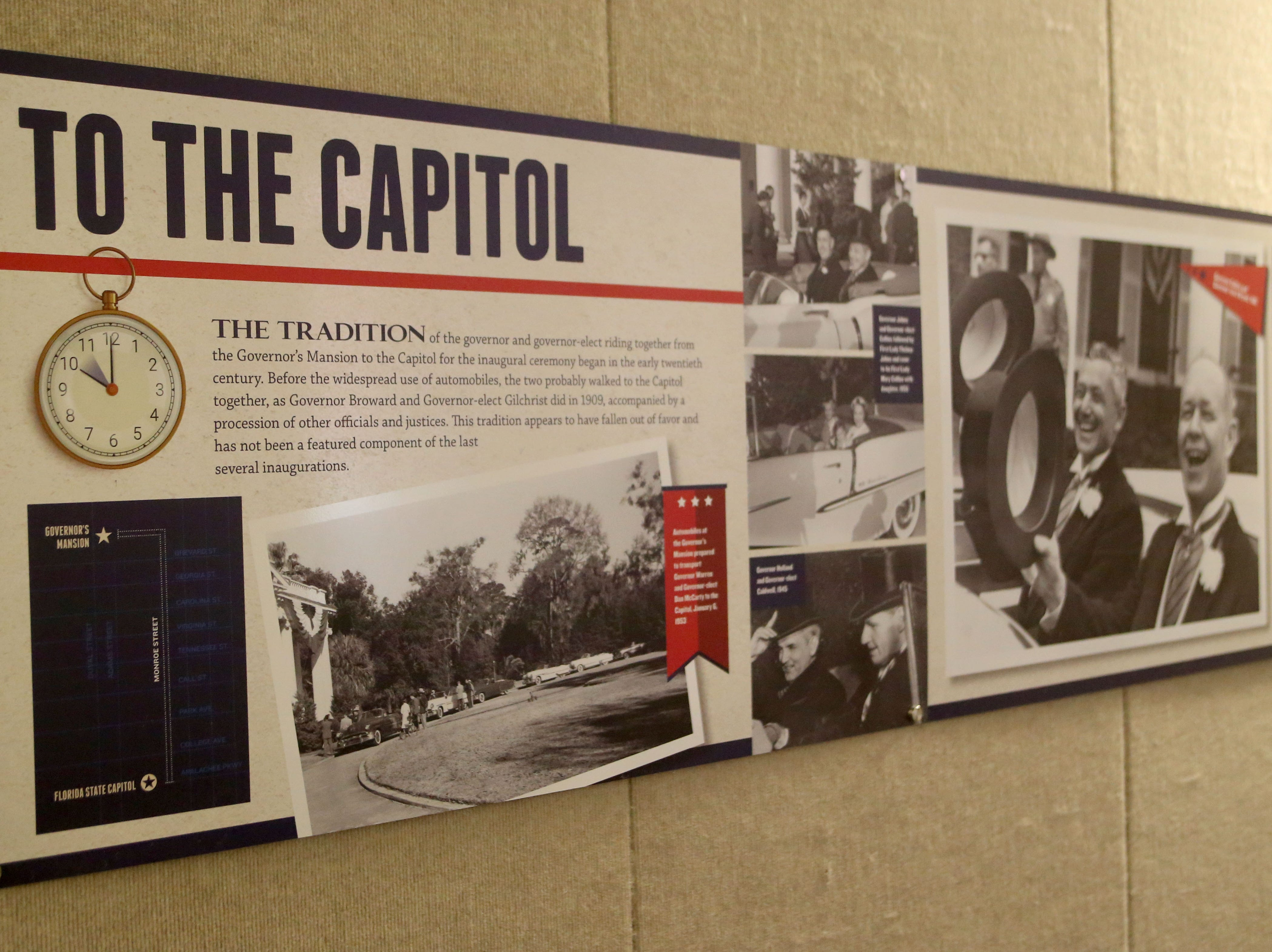 The Tallahassee historic Capitol hosts an exhibit on inaugurations of years past. A poster detailing the tradition of the governor and the governor-elect riding from the Governor's Mansion to the Capitol is displayed on a wall in the exhibit, Wednesday, Nov. 28, 2018.