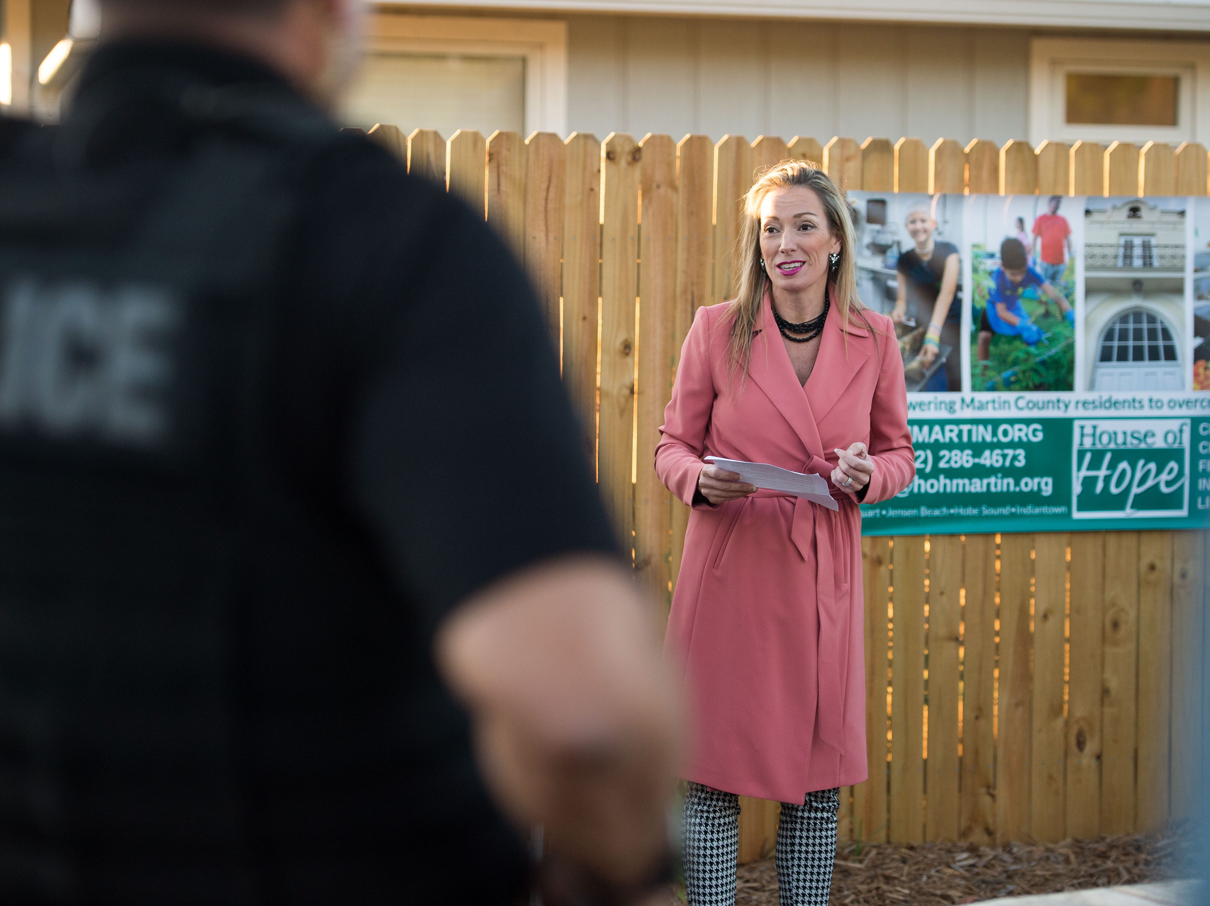 The House of Hope, City of Stuart Commissioners and the local neighborhood celebrate the official ribbon cutting for the new East Stuart Community Garden on Tuesday, Nov. 27, 2018, in Stuart. The collaborative garden site will offer educational opportunities for gardening and better nutrition, as well as help supply local pantries and soup kitchens with fresh produce.