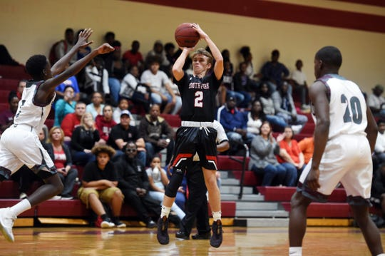 South Fork High School's Gabe Jones puts up a shot from three-point range Tuesday, Nov. 27, 2018 during a game against Fort Pierce Westwood in Fort Pierce. Westwood won the game 70-60.