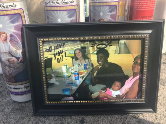 Someone left a photo of Anthony Martin, 16, at a memorial on South 25th Street near Midway Road, where he died in a crash Nov. 23, 2018.