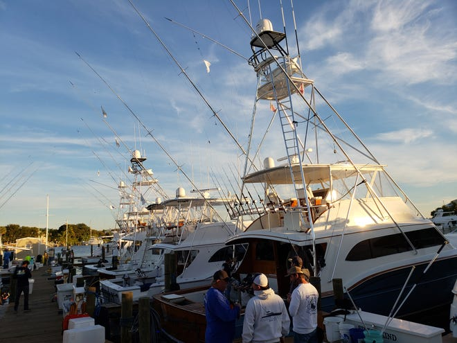 The boat Floridian in the background won its second daily award this tournament season, in just four days of competition, after catching and releasing four sailfish Saturday in the Pirates Cove Sailfish Classic.