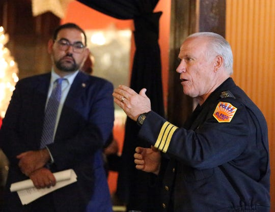 El Paso police Assistant Chief Peter Pacillas talks about staffing levels, priorities and other department issues during a meeting put on by city Rep. Peter Svarzbein, left in background.