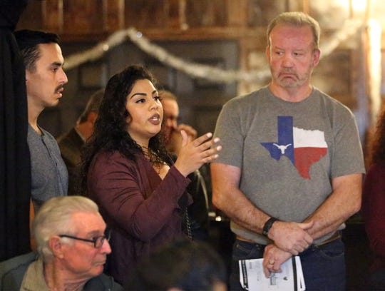 Lisa Sanchez, center, a friend of Amanda 'Mandy' Weyant Ferguson expresses her concern about safety issues at Mesa Street and Cincinnati Ave. Tuesday night. At right is Dan Ferguson, father of Amanda Ferguson.