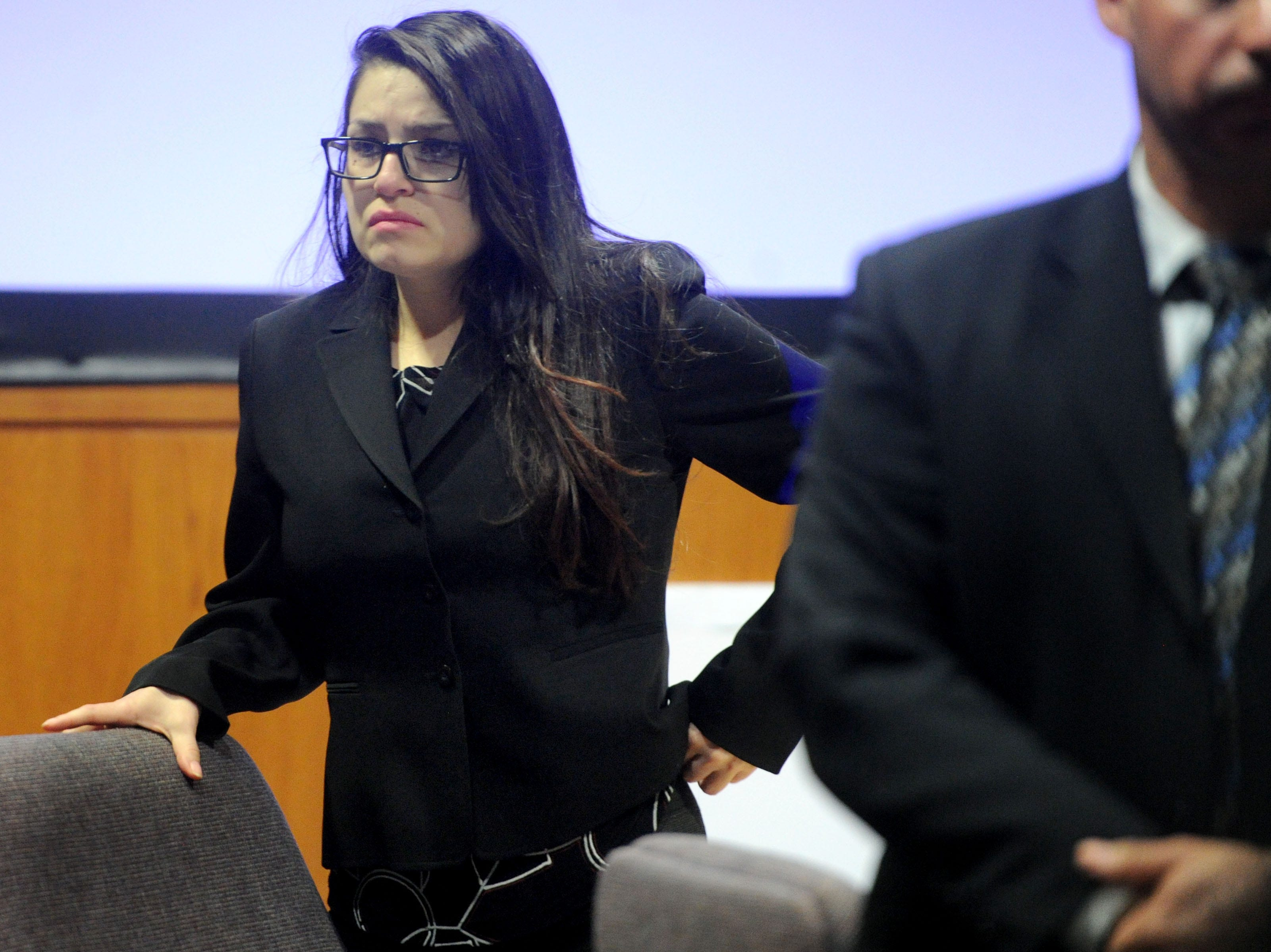 Mayra Chavez, 27, stands up as the jurors come inside the courtroom Tuesday for the opening statements of her trial at Ventura County Superior Court. She is accused of killing her 3-year-old daughter Kimberly Lopez who authorities believe to be dead somewhere in Mexico.