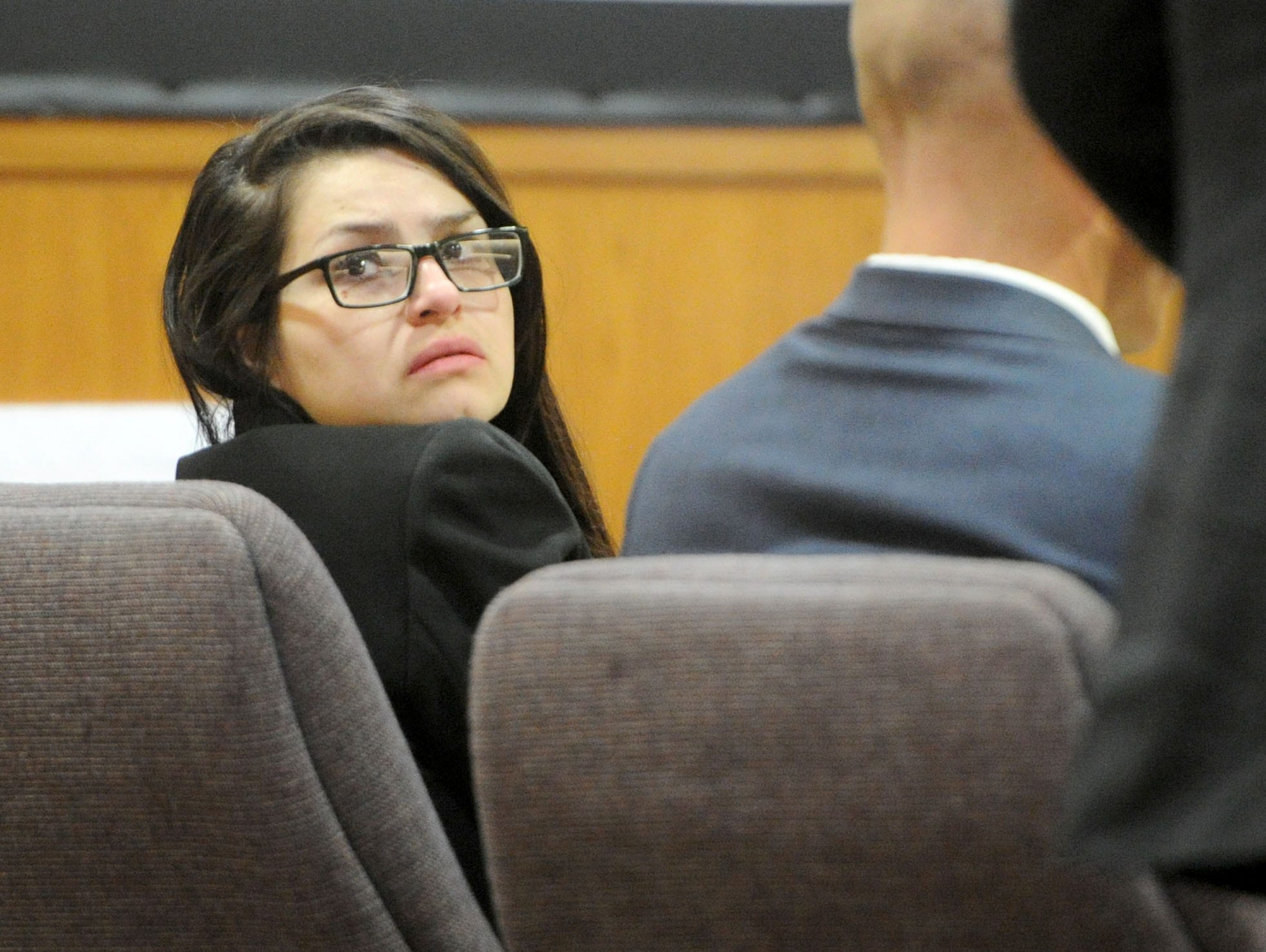Mayra Chavez looks over her shoulder Tuesday as a witness steps forward at her trial in Ventura County Superior Court. She is accused of killing her 3-year-old daughter Kimberly Lopez who authorities believe to be dead somewhere in Mexico.