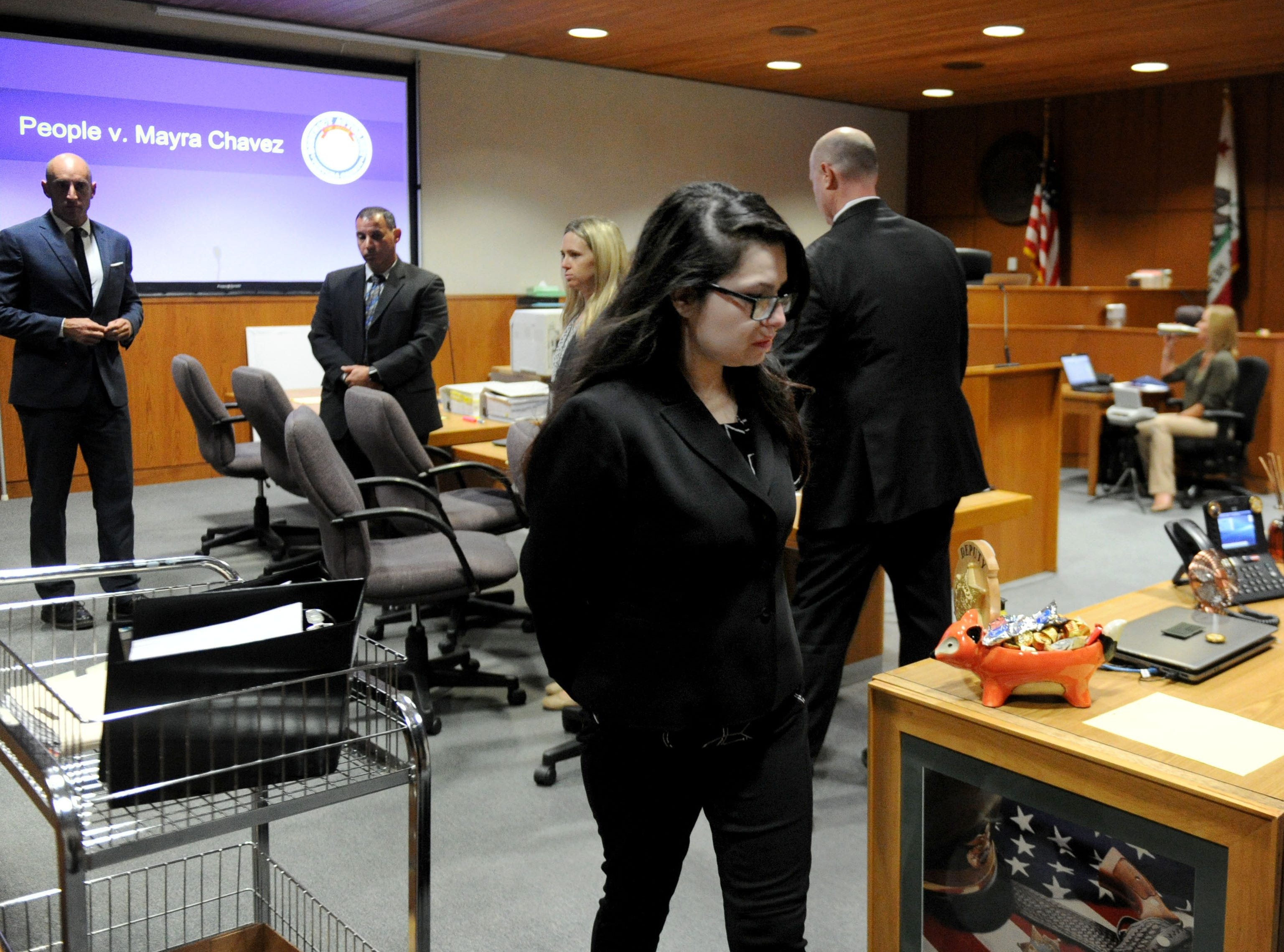 Mayra Chavez, 27, returns to her containment cell after the opening statements Tuesday at Ventura County Superior Court. She is accused of killing her 3-year-old daughter Kimberly Lopez who authorities believe to be dead somewhere in Mexico.