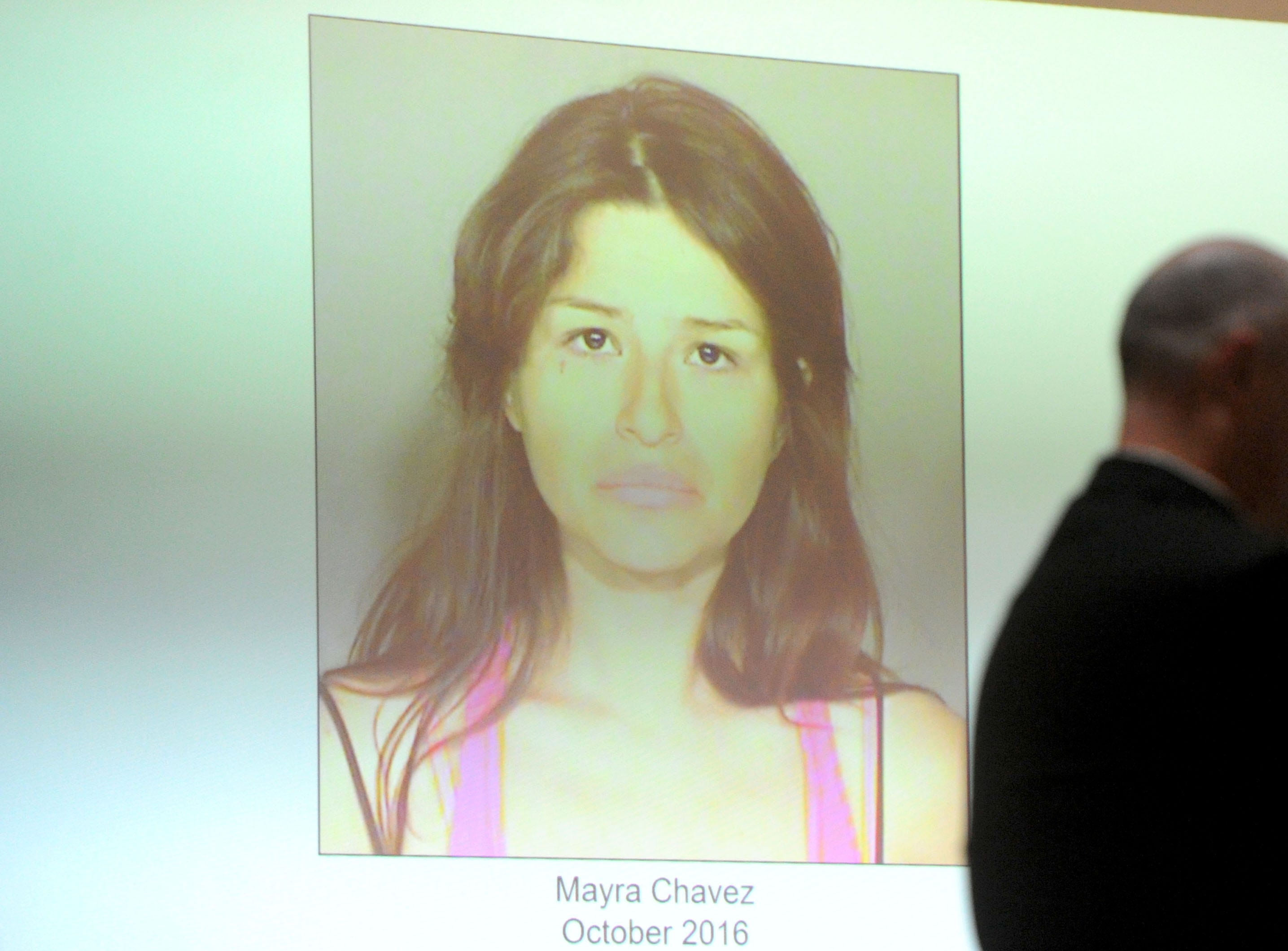 Senior Deputy District Attorney John Barrick shows a photo of Mayra Chavez during opening statements Tuesday in her trial at Ventura County Superior Court. She is accused of killing her 3-year-old daughter Kimberly Lopez who authorities believe to be dead somewhere in Mexico.