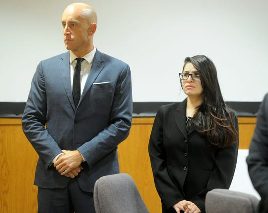 Deputy Public Defender Michael Albers (left) and defendant Mayra Chavez stand as jurors enter the courtroom during her trial at Ventura County Superior Court. Chavez is charged with second-degree murder in the death of her 3-year-old daughter, Kimberly Lopez.
