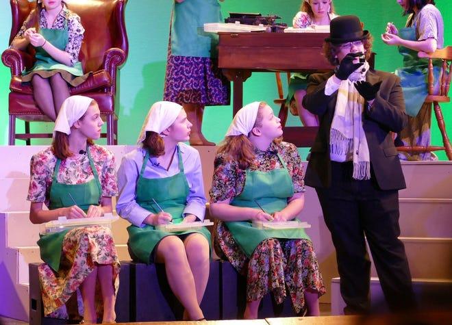"(From left) Rebecca Wax, Malina Chappius, Hanna Sharkey and Max Tucker rehearse a scene from Cumberland Regional High School's production of ""Radium Girls."""