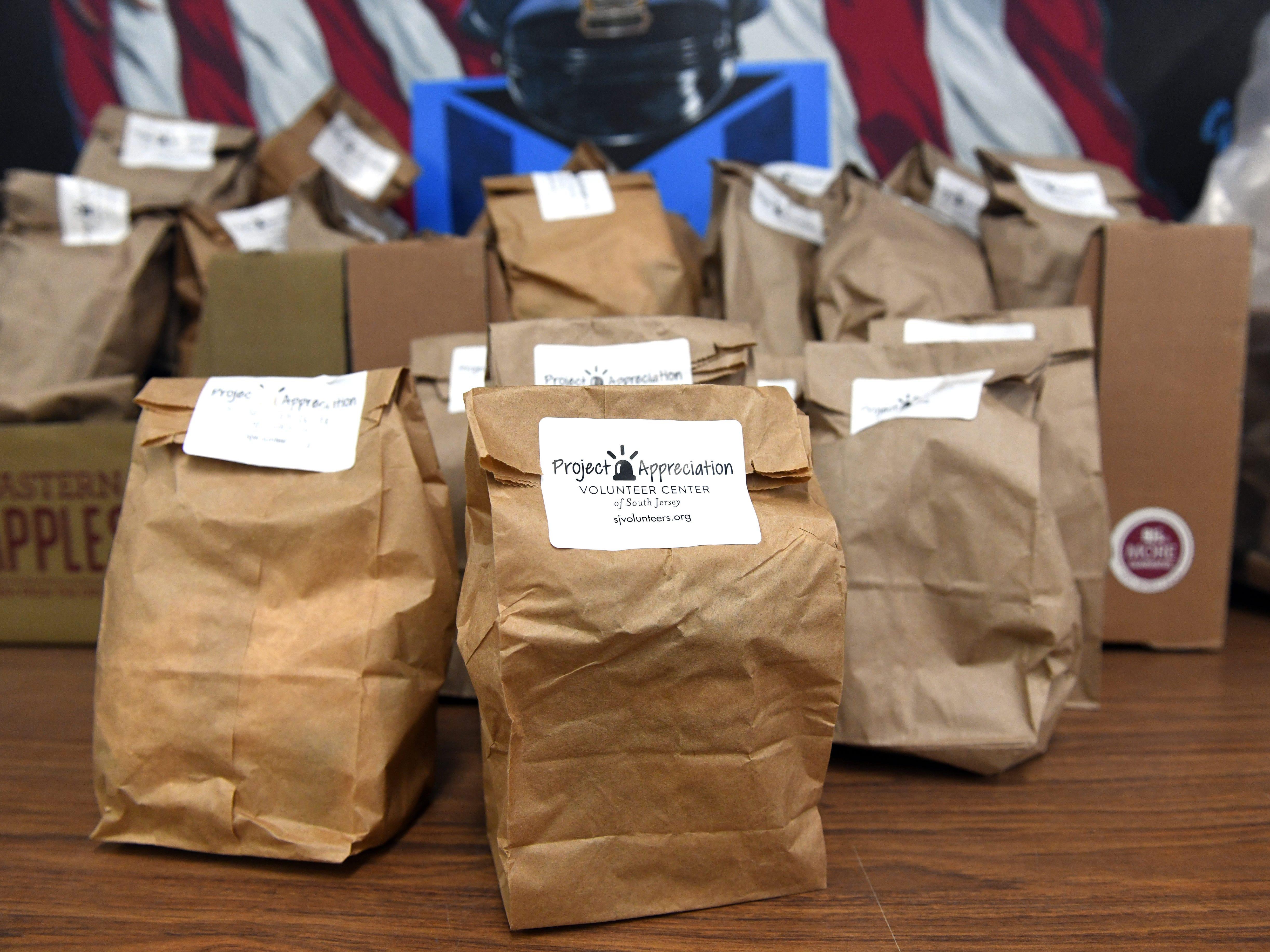 "Members of the Volunteer Center of South Jersey delivered gift bags to the Vineland Police Department as part of their Project Appreciation initiative on Wednesday, November 28, 2018. The ""thank you"" bags contain a variety of items such as a coffee pod, power bar, cough drops, napkins, hand sanitizer and more."