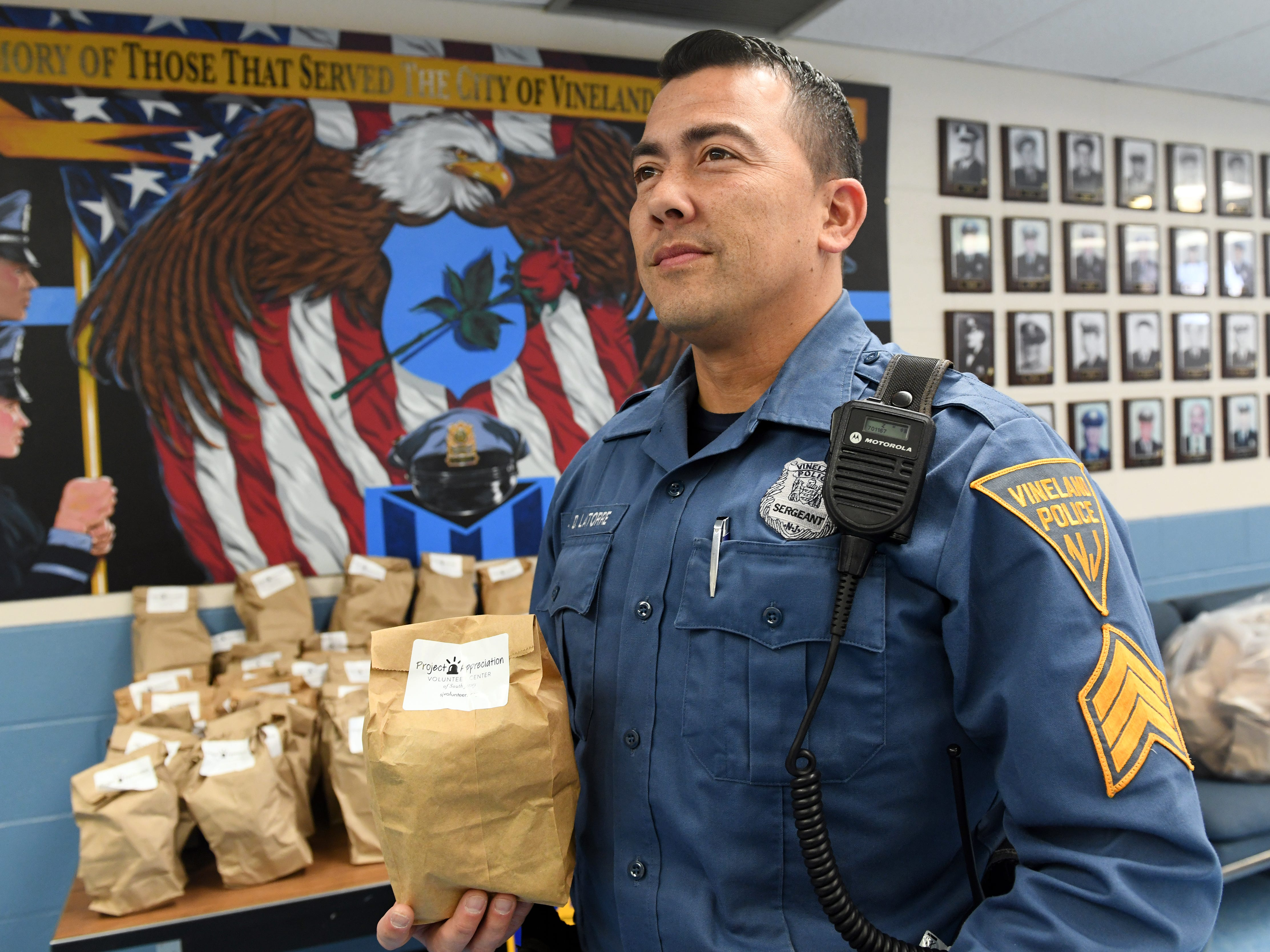 "Sergeant Danny Latorre holds a appreciation bag that was delivered by the Volunteer Center of South Jersey. The ""thank you"" bags contain a variety of items such as a coffee pod, power bar, cough drops, napkins, hand sanitizer and more."