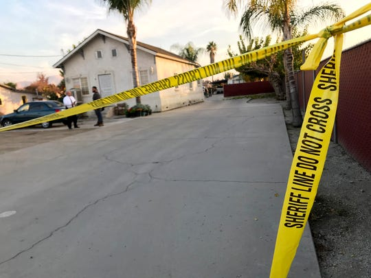 Tulare County sheriff's deputies investigate a homicide in the 1100 block of East Date Avenue in Porterville on Tuesday, November 27, 2018.