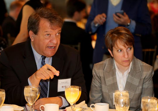 Westchester County Executive George Latimer, left, speaks with Leslie Gordon of Feeding Westchester and others during the annual breakfast of the Westchester Business Council at Tappan Hill in Tarrytown Nov. 28, 2018. Latimer was the guest speaker at the breakfast.