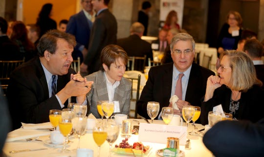 Westchester County Executive George Latimer, left, speaks with Leslie Gordon of Feeding Westchester, John Ravitz, Executive Vice President of the Westchester Business Council, and Susan Fox of the Westchester Institute for Human Development during the annual breakfast of the Westchester Business Council at Tappan Hill in Tarrytown Nov. 28, 2018. Latimer was the guest speaker at the breakfast.
