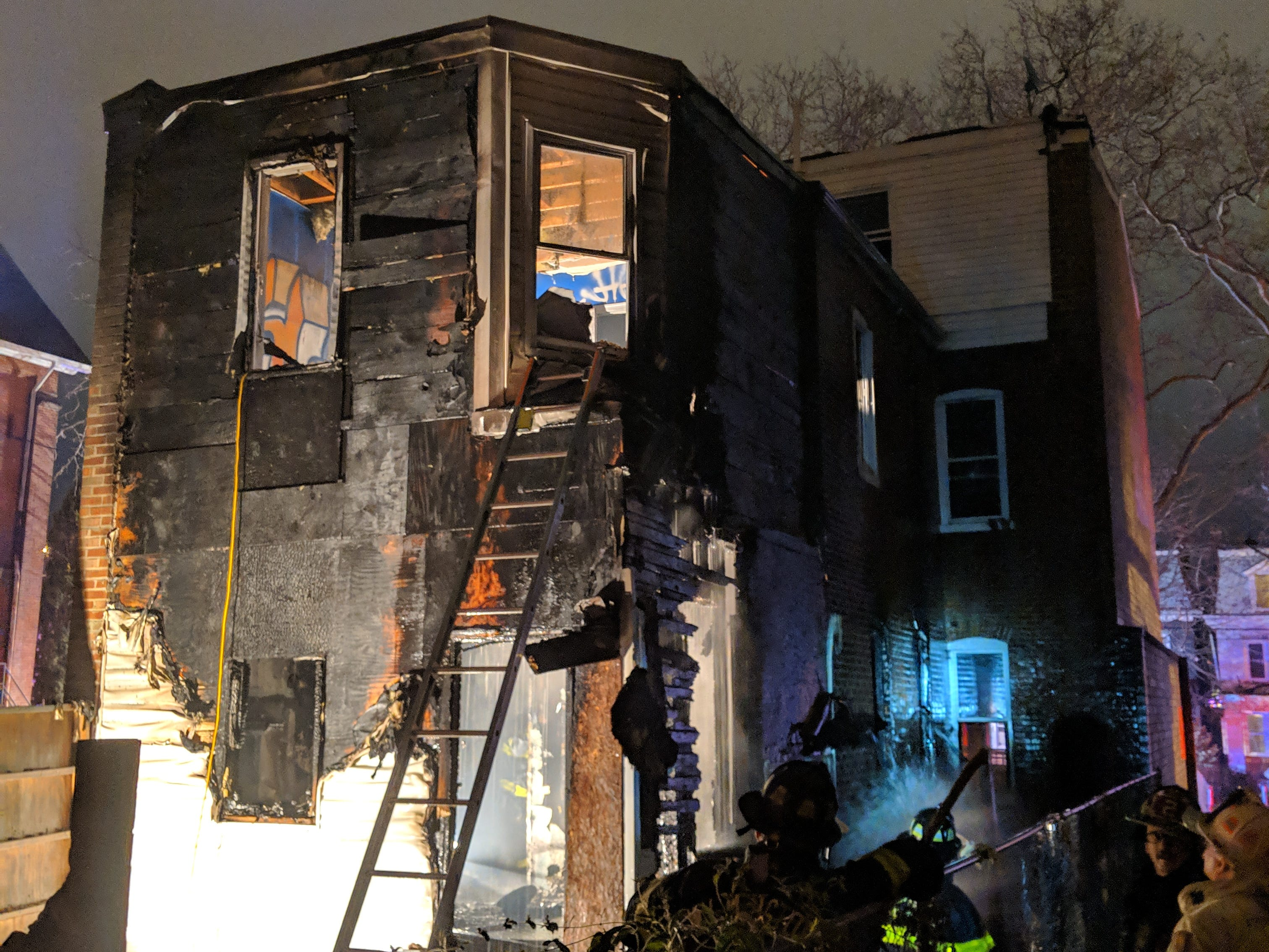 Wilmington firefighters work at the scene of a house fire in a vacant home on the 300 block of N. Broom Street, reported shortly after 9 p.m. There were no reports of injuries.