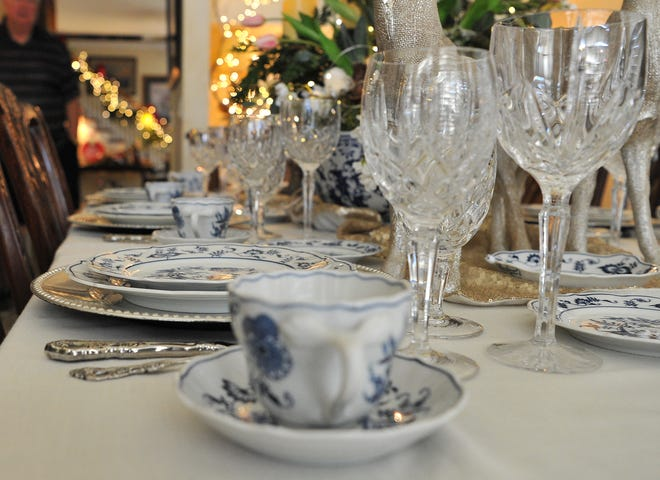 Christmas dining and stemware decorate the dining area of Dwight and Mary Ann Recht's home. The Recht's home will be open during the 39th annual Christmas Tour of Homes.
