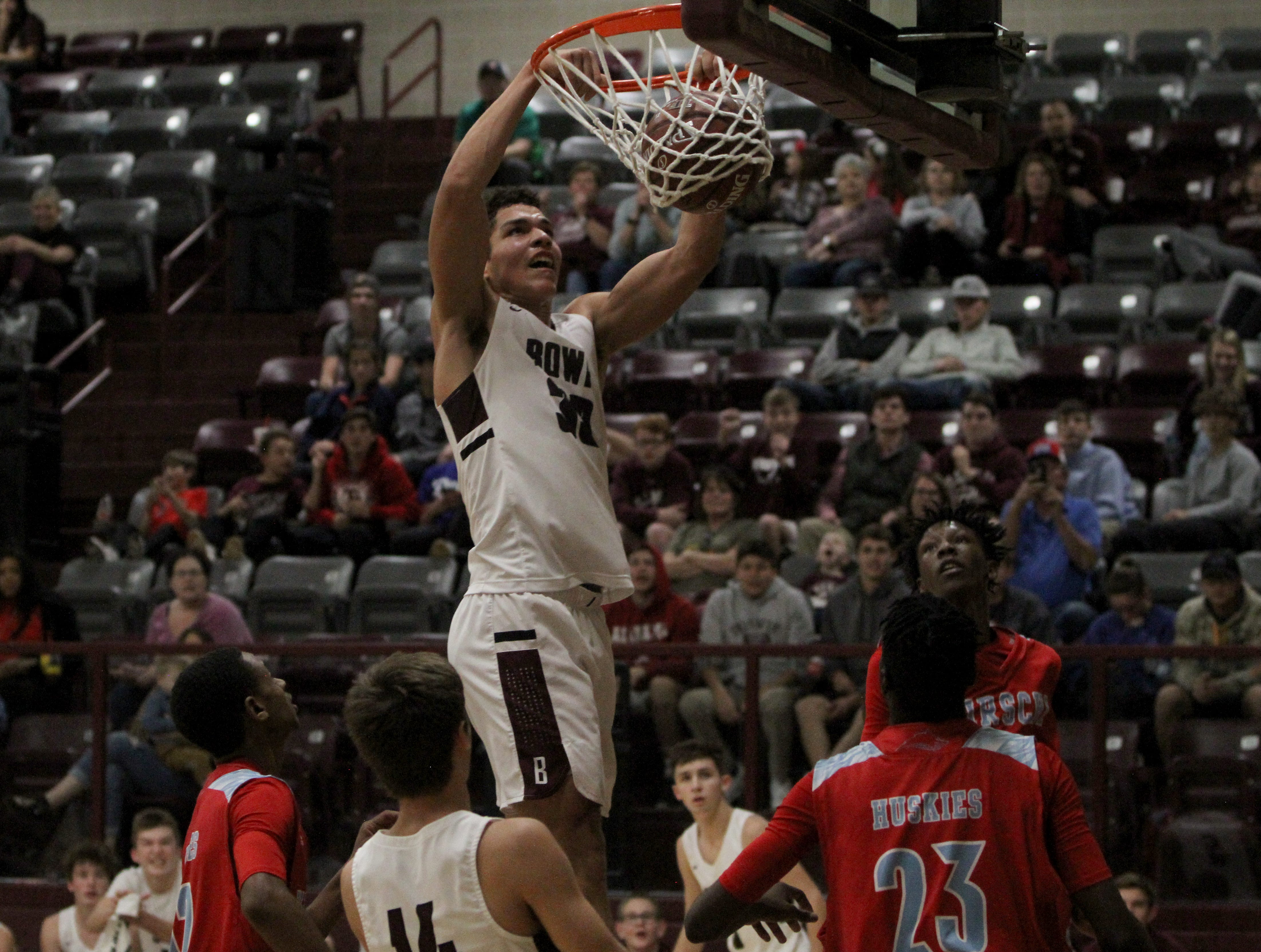 Bowie's Daniel Mosley dunks in the game against Hirschi Tuesday, Nov. 27, 2018, in Bowie. The Jackrabbits defeated the Huskies 67-53.