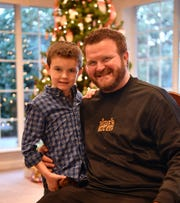 Dustin Holly and his son, Jackson, 6, in the Great Room at Hospice of Wichita Falls. The Hospice Tree of Lights holds special meaning for the Holly's after Dustin's mother, Pam Pitts, was a patient in November 2013.