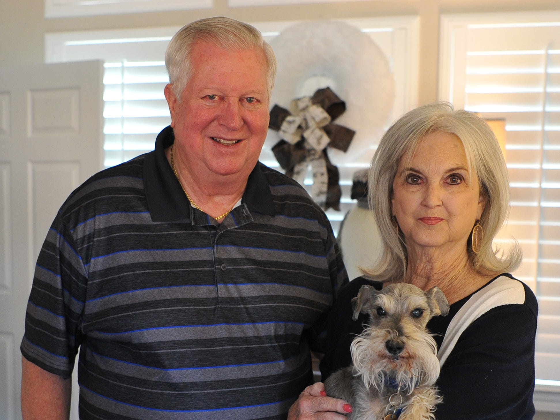 Dwight and Mary Ann Recht pose for a photo with their dog, Chipper after giving the TRN a tour of their home. The Recht's home will be one-of-several that will be part of the 39th annual Christmas Tour of Homes.