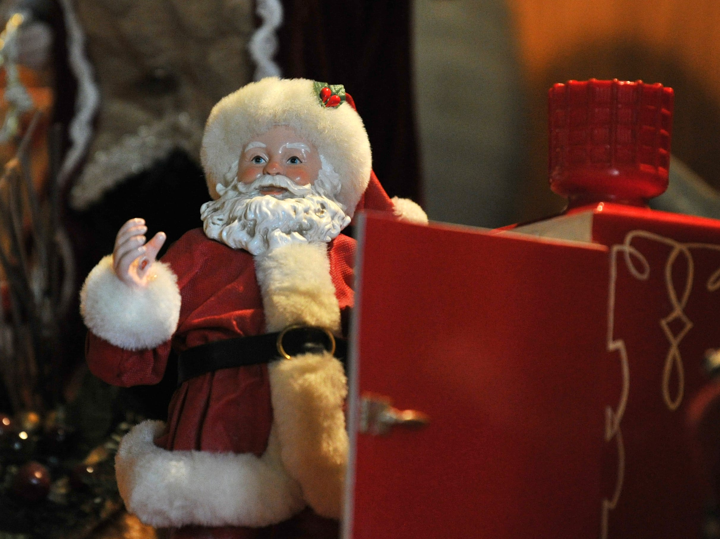 A miniature Santa Claus is one-of-several Christmas decoration that will be displayed at the Recht's home during the 39th annual Christmas Tour of Homes.